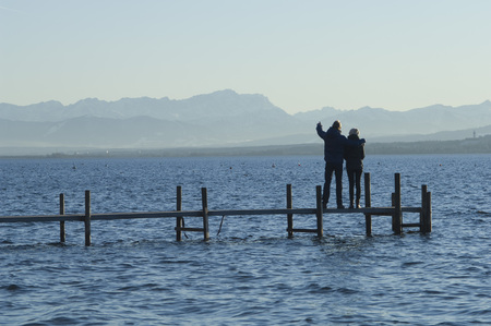 Europe,Germany,Bavaria,Man And Woman Relaxing At Lake Ammersee
