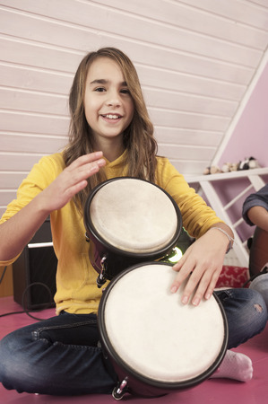 Girl Playing Drums,Smiling,Portrait
