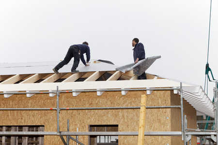 Europe,Germany,Rhineland Palatinate,Workers Roofing On House LANG_EVOIMAGES