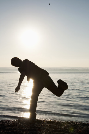 Germany,Bavaria,Boy Playing On Shore At Lake Ammersee