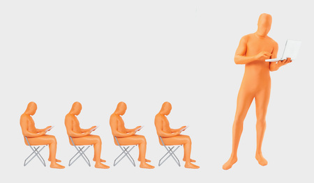 Men In Orange Zentai Using Laptop And Digital Tablet LANG_EVOIMAGES