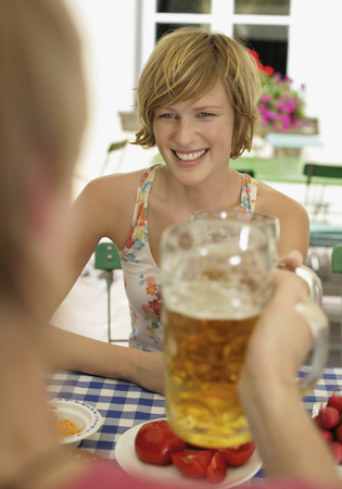 Germany,Young Couple In Beer Garden,Smiling