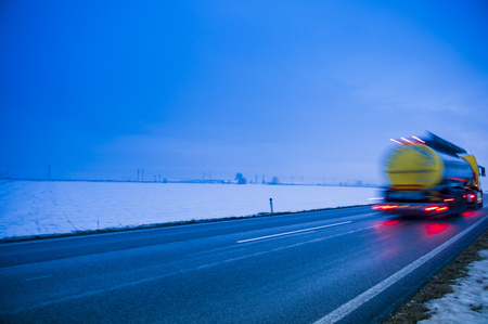 Austria,Cargo Truck Moving On Country Road In Winter LANG_EVOIMAGES