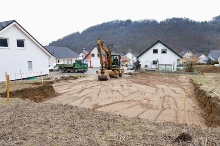 Europe,Germany,Rhineland Palatinate,Man Prepairing Ground For House Foundation