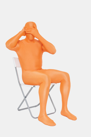 Mature Man In Orange Zentai With Hands Covering Eyes LANG_EVOIMAGES