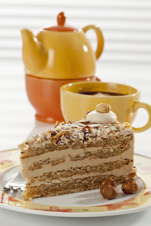 Slice Of Noisette Cake With Cup Of Coffee,Close Up