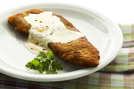 Plate Of Schnitzel With Cheese On Napkin,Close Up