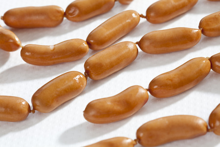 Raw Sausage On White Background, Close Up