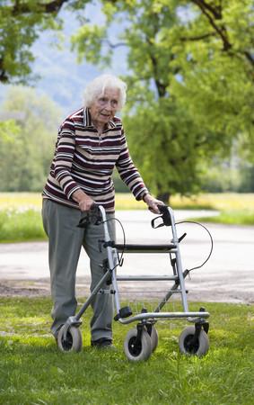 Austria,Senior Woman Pushing Walking Frame