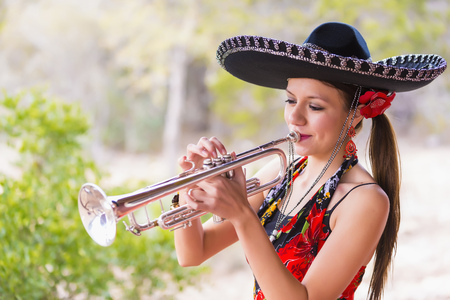 Usa,Texas,Young Woman Playing Trumpet