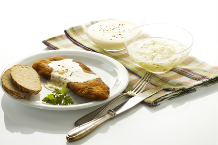 Plate Of Schnitzel With Bread And Cheese In Bowl,Close Up