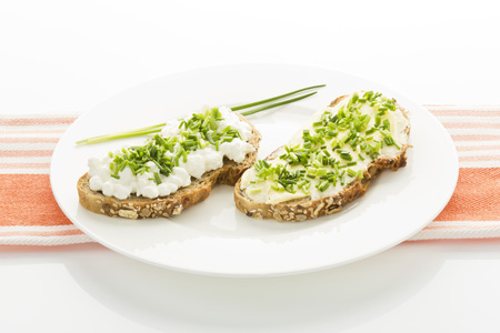 Cottage Cheese,Butter And Chives On Whole Grain Bread,Close Up