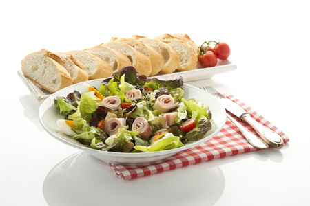 Plate Of Salad With Ham And Cheese And Bread In Tray On White Background,Close Up
