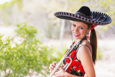 Usa,Texas,Young Woman Holding Trumpet,Smiling,Portrait LANG_EVOIMAGES