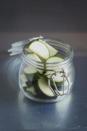 Pieces Of Zucchini In Glass Jar,Close Up