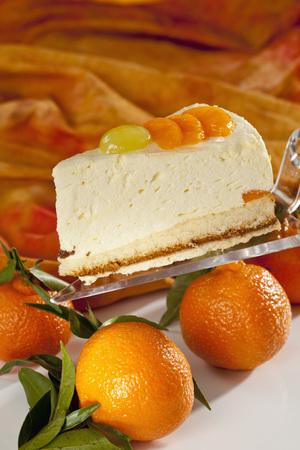 Mandarin Cream Cake On Cake Server Besides Mandarins,Close Up