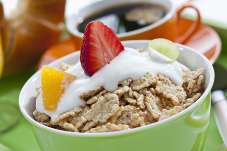 Bowl Of Muesli, Yogurt And Fruits With Coffee Cup And Croissant LANG_EVOIMAGES
