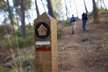 Spain, Mallorca, Wooden Post On Hiking Trail In Tramuntana Mountains