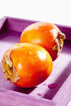 Kaki Persimmon In Wooden Tray,Close Up