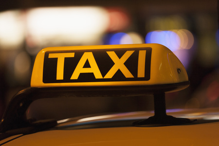 Germany, Bavaria, Munich, Illuminated Sign On Taxi Showing Availability