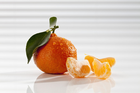 Mandarin With Leaf And Pieces,Close Up