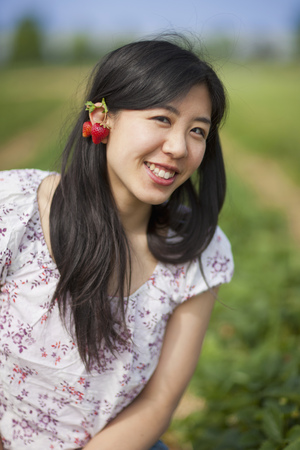 Germany, Bavaria, Young Japanese Woman With Strawberry Earrings