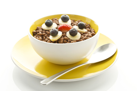 Breakfast Bowl Of Choclate Chip Cereals With Banana,Blueberry And Strawberry