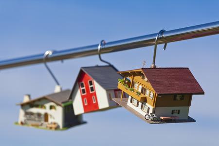 Germany, Baden Wuerttemberg, Stuttgart, House Model Hanging On Steel Rod