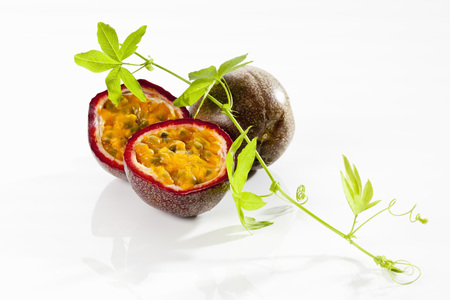 Passion Fruits With Tendril On White Background,Close Up