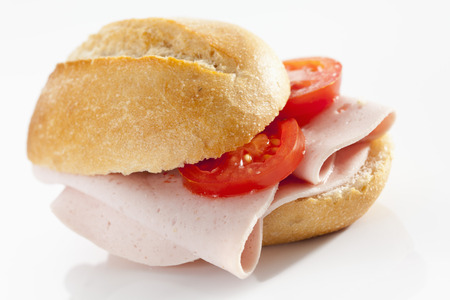 Sandwich Of Bread Roll With Bologna Sausage On White Background, Close Up LANG_EVOIMAGES