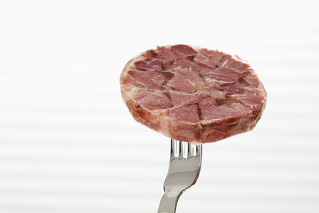 Slice Of Boar In Aspic On Fork, Close Up