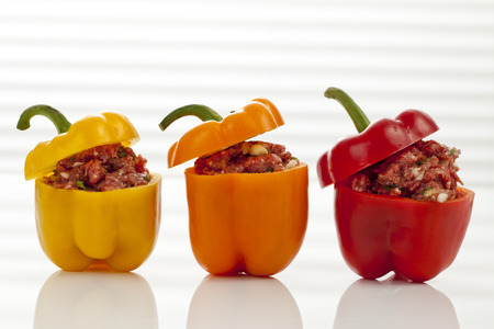 Yellow, Orange And Red Bell Peppers Filled With Minced Meat, Close Up
