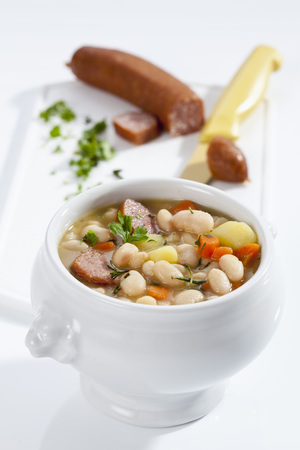 Bowl Of White Bean Soup With Smoked Sausage,Close Up