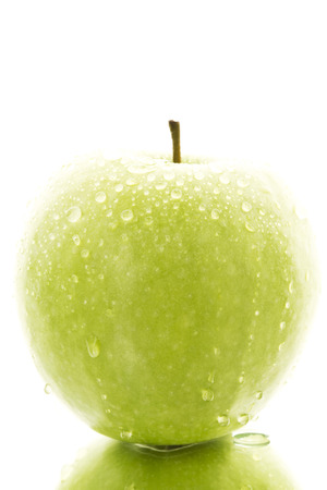 Granny Smith With Water Drops On White Background, Close Up