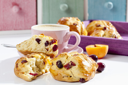 Cranberry Scones With Apricot And Cup Of Coffee On Wooden Tray,Close Up