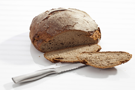 Farmhouse Bread With Knife On White Background, Close Up
