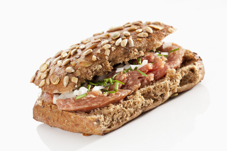 Sandwich Of Grain Bread Roll With Ground Ham On White Background, Close Up LANG_EVOIMAGES