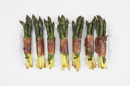 Asparagus With Saltimbocca, Sage Leaf And  Parma Ham On Porcelain Plate LANG_EVOIMAGES