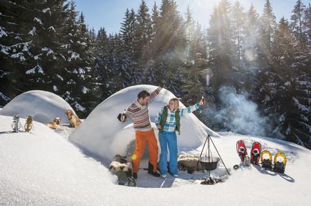 Austria,Salzburg,Couple Having Fun In Front Of An Igloo