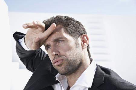 Tired Businessman In Black Suit,Looking Away