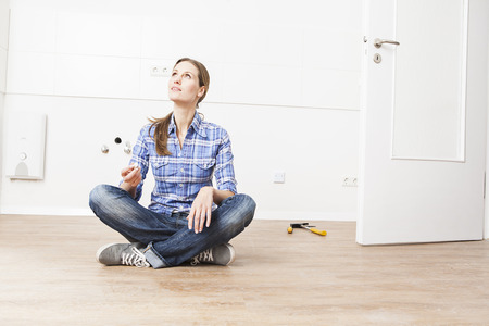 Woman Sitting On Floor,Looking Up