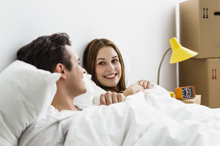 Young Couple Looking At Each Other,Smiling