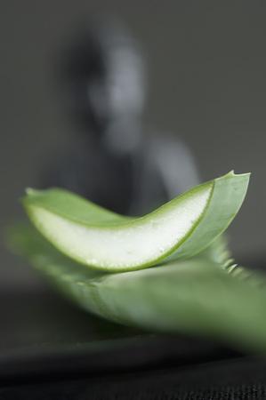 Slice Of Aloe Vera Leaf,Statue Of Buddha In Background