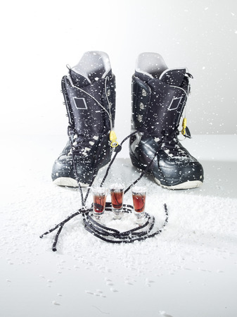 Snowboard Shoes With Drink On White Background LANG_EVOIMAGES