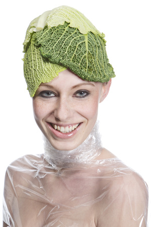 Portrait Of Young Woman With Cabbage Cap Against White Background,Close Up