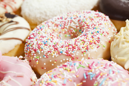 Variety Of Doughnuts Topped With Icing And Sprinkles,Close Up LANG_EVOIMAGES