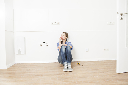 Woman Sitting On Floor,Looking Away LANG_EVOIMAGES