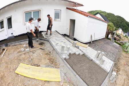 Germany,Rhineland Palatinate,Workers Assembling Paving Stone