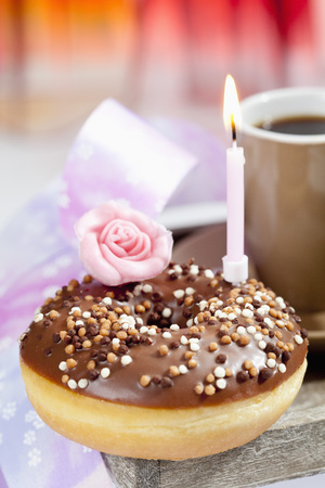 Doughnut With Illuminated Birthday Candle,Close Up
