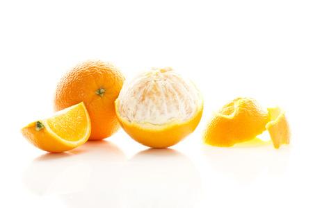 Peeled And Whole Oranges On White Background,Close Up